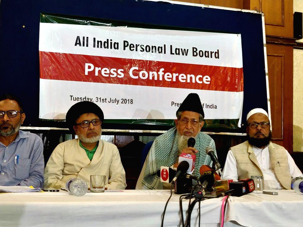 All India Muslim Personal Law Board (AIMPLB) Vice-President Maulana Syed Jalaluddin Umari addresses a press conference along with AIMPLB Secretary Zafaryab Jilani and other members of the ...