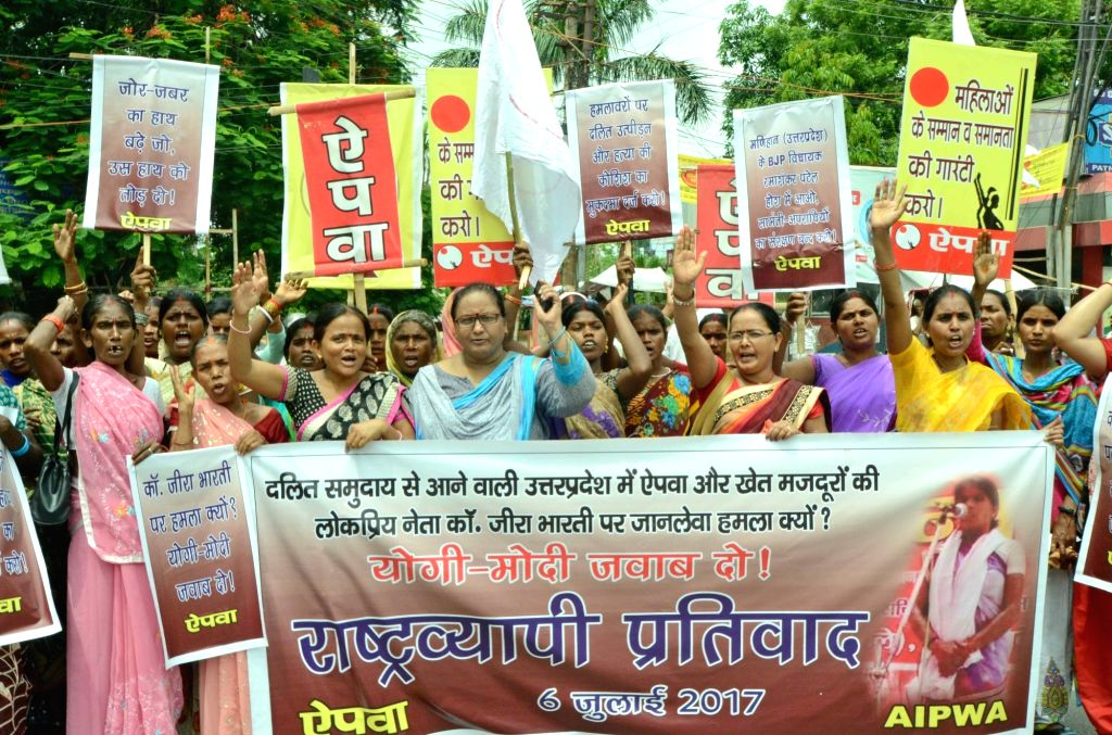 All India Progressive Women's Association (AIPWA) members stage a demonstration to press for their various demands in Patna on July 6, 2017.