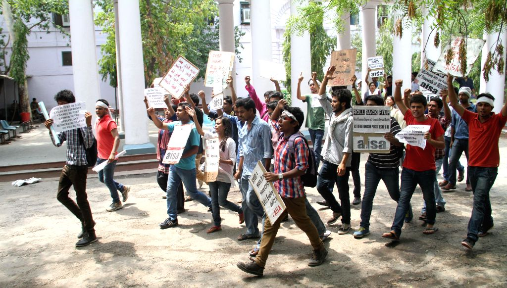 All India Students Association (AISA) demonstrate against FYUP in New Delhi on June 26, 2014.