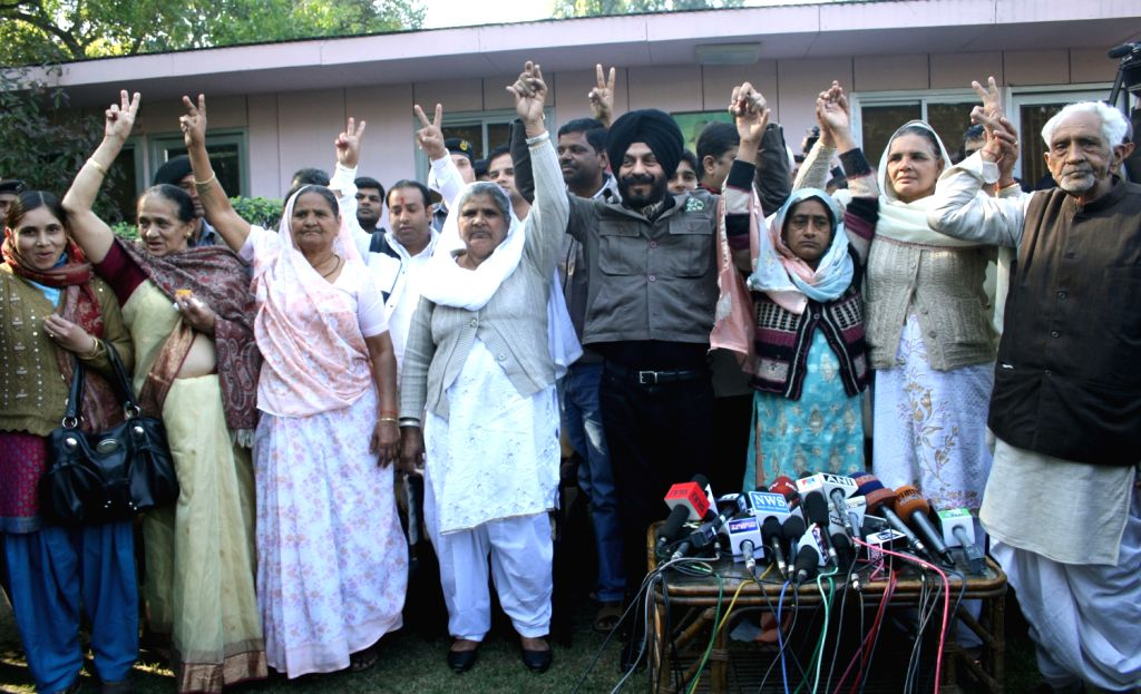 All India Terrorist Front President M S Bitta Celebrating hanging of Afzal Guru with relatives of Parliament attack victims in New Delhi 09 Feb 2013.