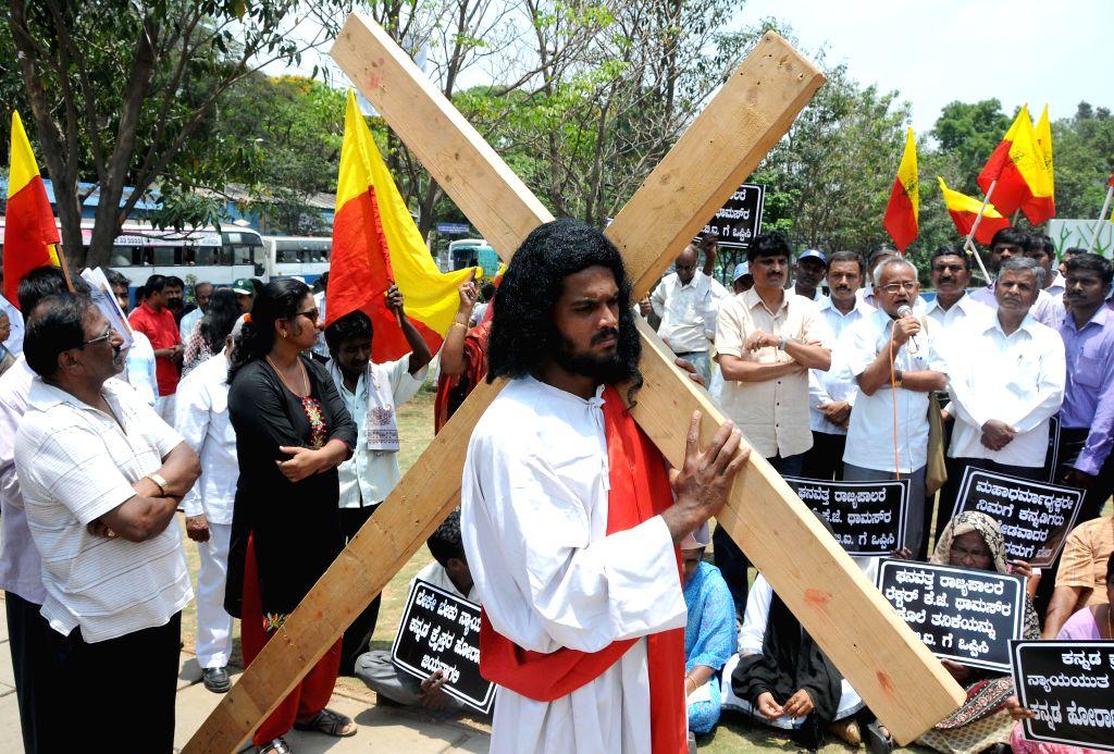 All Karnataka Catholic Christian Kannada Association members demonstrate at Freedom Park to demand CBI inquiry in KJ Thomas murder case in Bangalore on April 18, 2014.