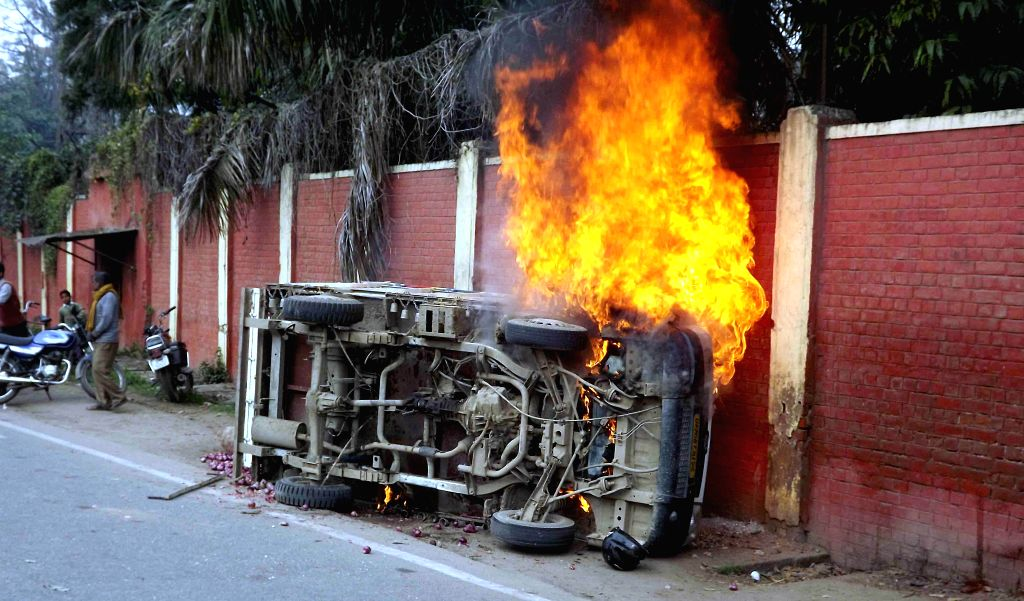 A vehicle that was torched by an irate mob in Allahabad on Feb 11, 2015. Reportedly the mob was chasing three men after they had shot at a local villager. One person was killed.