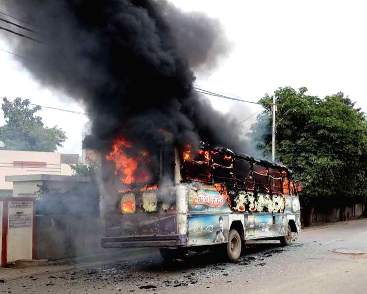 :Allahabad: Angered over the killing of a Dalit student of Allahabad University, students sets a bus on fire in Allahabad on Feb 12, 2018. (Photo: IANS).