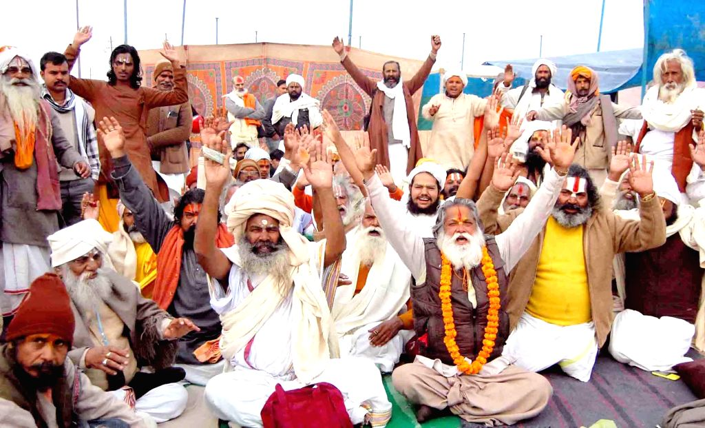 Ascetics stage a demonstration against the authorities regarding space allotted to them for Sangam in Allahabad, on Dec 20, 2014.