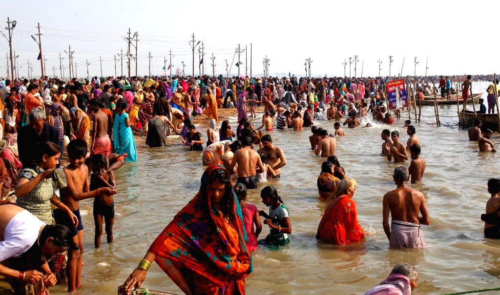Devotees take a holy dip in Sangam, Allahabad on Feb. 1, 2015.