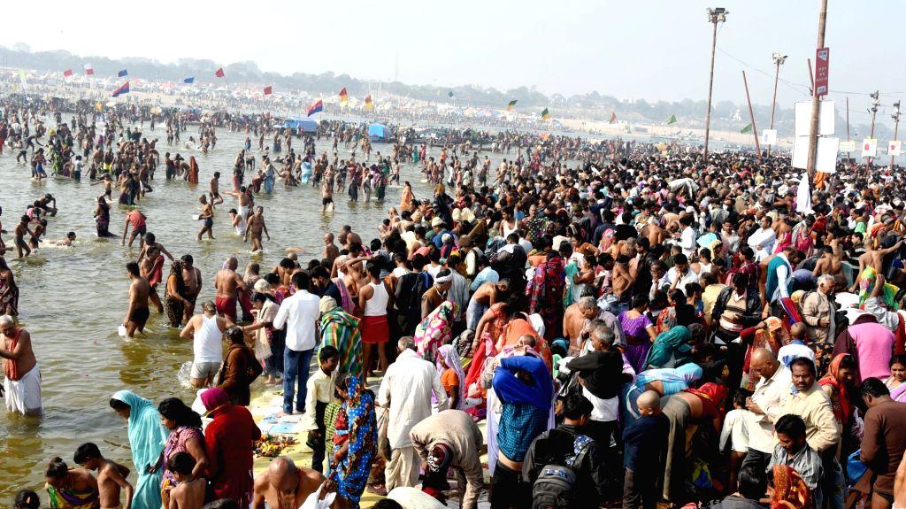 Allahabad: Devotees throng Sangam -- the confluence of the three holy rivers Ganga, Yamuna and the mythical Saraswati on Mauni Amavasya, to take holy dip; in Allahabad on Jan 16, 2018. (Photo: IANS)