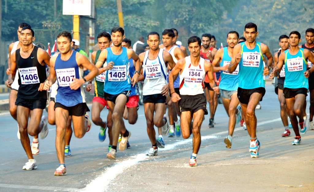 People participate in 30th All India Indira Marathon organised on the birth anniversary of former Indian prime minister Indira Gandhi in Allahabad, on Nov 19, 2014. - Indira Gandhi