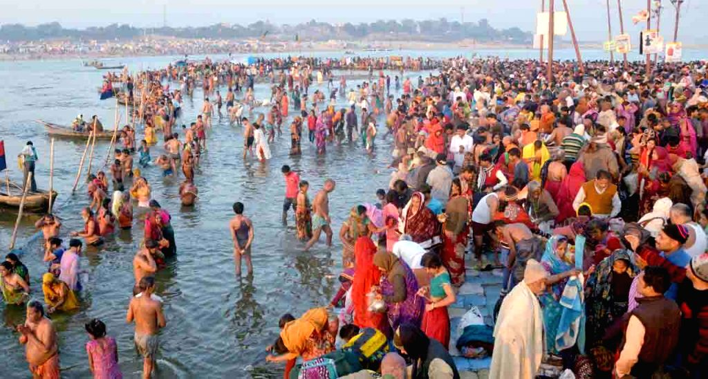 Allahabad: People throng Sangam to take a holy dip on Maghi Purnima in Allahabad on Jan 31, 2018. (Photo: IANS)