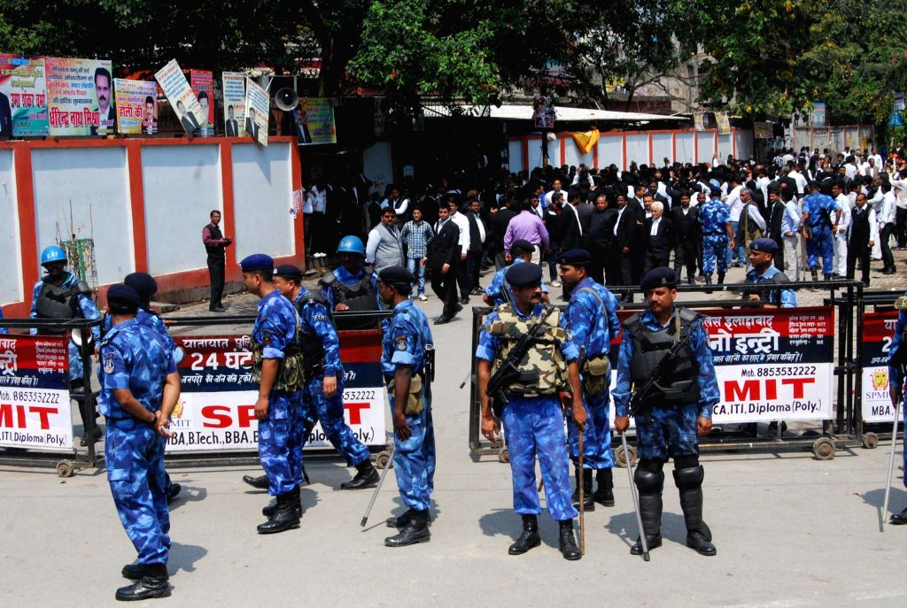 RAF jawans stand guard as lawyers stage a demonstration at the Allahabad district court on March 16, 2015.