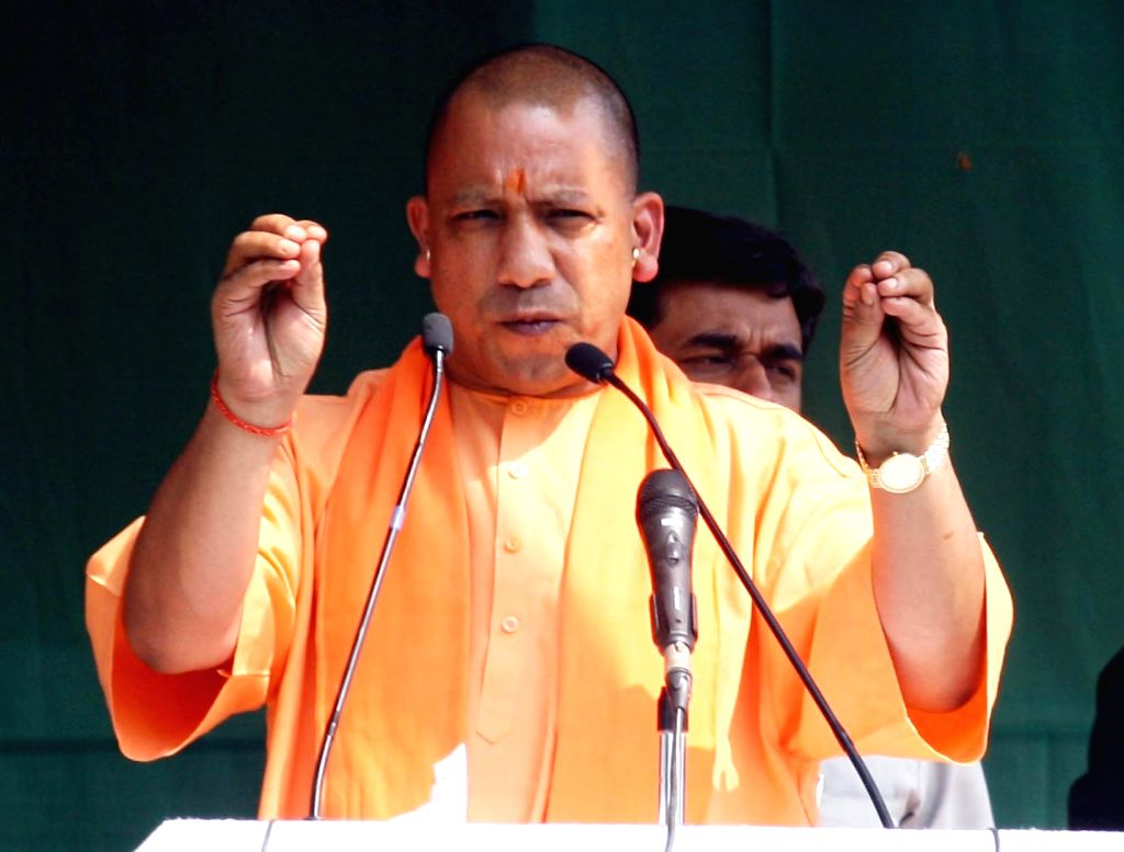 Allahabad: Uttar Pradesh Chief Minister and BJP leader Yogi Adityanath addresses during an election rally ahead of Phulpur by polls, in Allahabad on March 8, 2018. (Photo: IANS)