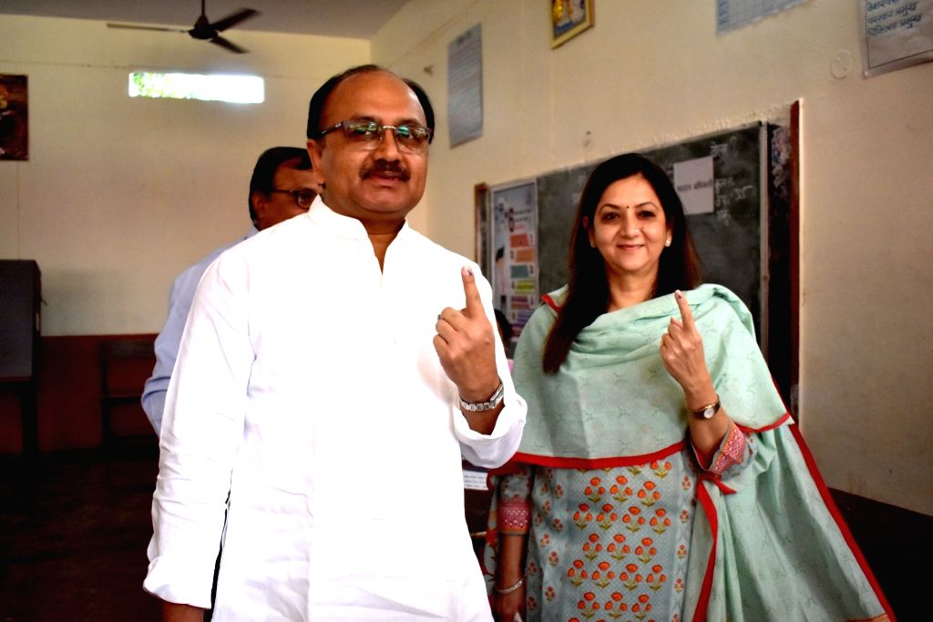 Allahabad: Uttar Pradesh Health Minister Sidharth Nath Singh along with his wife Neeta Singh show their forefingers marked with indelible ink after casting their vote during the sixth phase of 2019 Lok Sabha elections, in Allahabad on May 12, 2019. ( - Sidharth Nath Singh and Neeta Singh