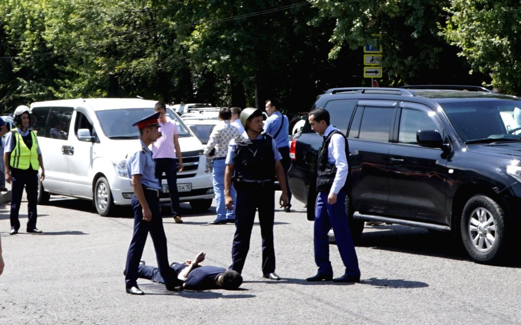 ALMATY, July 18, 2016 - Police officers detain a man at a scene of shooting on the street in Almaty, Kazakhstan, July 18, 2016. Several armed men opened fire towards pedestrians in the street in the ...