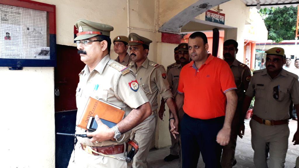 Alok Singh, the man accused of murdering his wife Reena Singh surrenders before police at Cantt Police Station in Varanasi, on July 25, 2019. - Alok Singh and Reena Singh