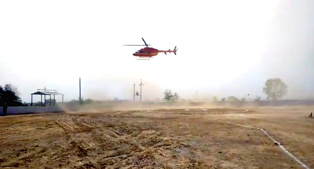 Alwar: BJP MP Mahant Balaknath had a close shave when the helicopter he was flying in lost balance and was seen swaying in the air while landing in Alwar on June 30, 2019. (Photo: IANS)