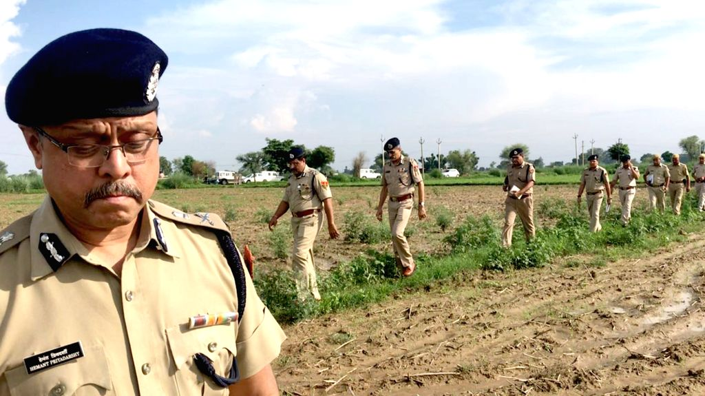 : Alwar: Senior police officers on their way to the site of attack where Rakbar alias Akbar was lynched on suspicion of smuggling cows; in Rajasthan's Alwar on July 23, 2018. The Rajasthan ...