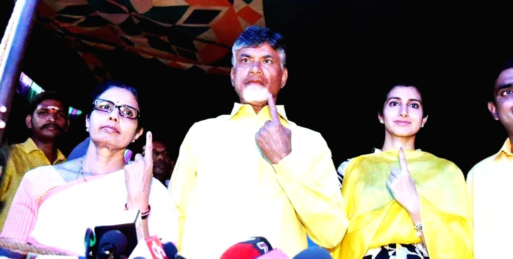 Amaravati: Andhra Pradesh Chief Minister and Telugu Desam Party (TDP) President N. Chandrababu Naidu and with his family members, show their inked fingers after casting their votes for during the first phase of ongoing 2019 Lok Sabha elections in Ama - N. Chandrababu Naidu