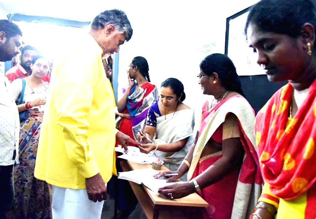 Amaravati: Andhra Pradesh Chief Minister and Telugu Desam Party (TDP) President N. Chandrababu Naidu gets his finger inked after casting vote during the ongoing first phase of 2019 Lok Sabha elections in Amaravati on April 11, 2019. Polling began on  - N. Chandrababu Naidu