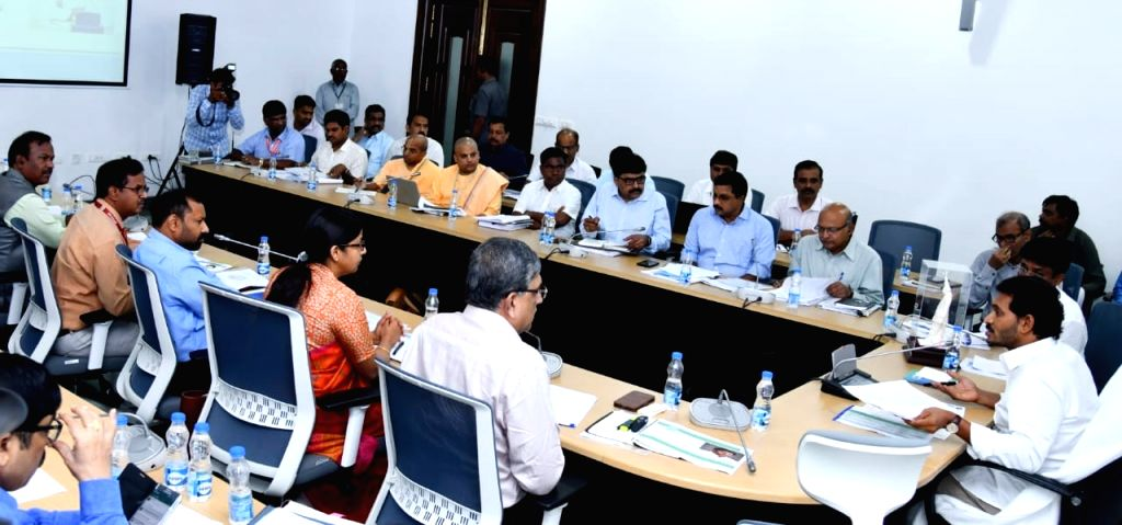 Amaravati: Andhra Pradesh Chief Minister Y. S. Jaganmohan Reddy chairs a meeting with officials from the education department, in Amaravati on June 27, 2019. At the meeting, the CM announced that mothers from poor families sending their children to j - Y. S. Jaganmohan Reddy