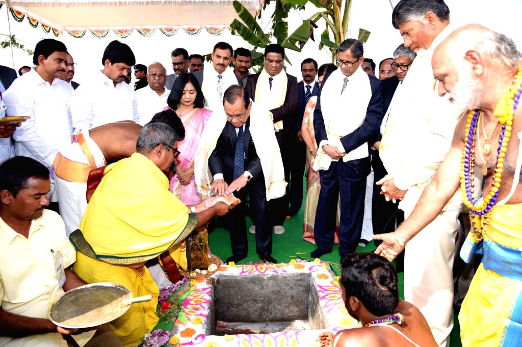 Amaravati: Chief Justice of India (CJI) Justice Ranjan Gogoi performs rituals at the foundation stone laying ceremony for the permanent building of Andhra Pradesh High Court in Amaravati, on Feb 3, 2019. He also inaugurated the interim complex of Hig - N. Chandrababu Naidu