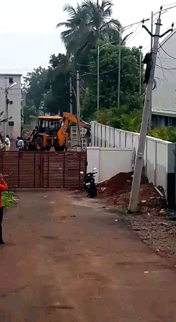 Amaravati: Demolition of a building adjacent to former Chief Minister N. Chandrababu Naidu's residence on the banks of Krishna river in full swing amid tension and tight security on Wednesday, as the Andhra Pradesh High Court; in Amaravati on June 26 - N. Chandrababu Naidu