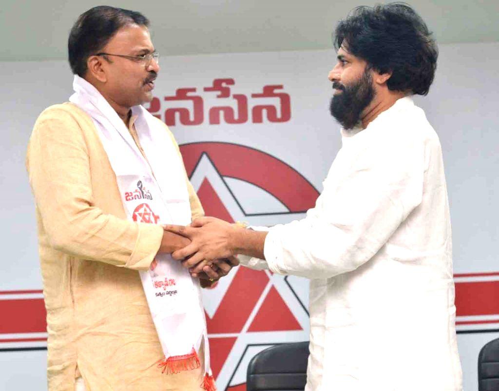 Amaravati: Former CBI Joint Director V.V. Lakshminarayana joins actor Pawan Kalyan's Jana Sena in Amaravati on March 17, 2019. (Photo: IANS) - Pawan Kalya