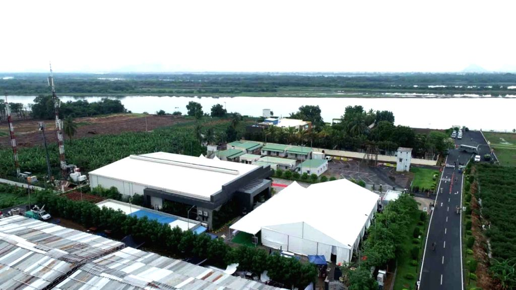 Amaravati: The building adjacent to former Chief Minister N. Chandrababu Naidu's residence on the banks of Krishna river that is being demolished amid tension and tight security, as the Andhra Pradesh High Court rejected the plea to put a stay on the - N. Chandrababu Naidu