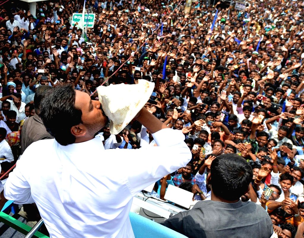 Amaravati: YSR Congress Party (YSRCP) chief Jagan Mohan Reddy blows a conch as he celebrates with party workers after the YSRCP emerged victorious in the Andhra Pradesh Assembly elections in Amaravati, on May 23, 2019. He will take oath as the new Ch - Jagan Mohan Reddy