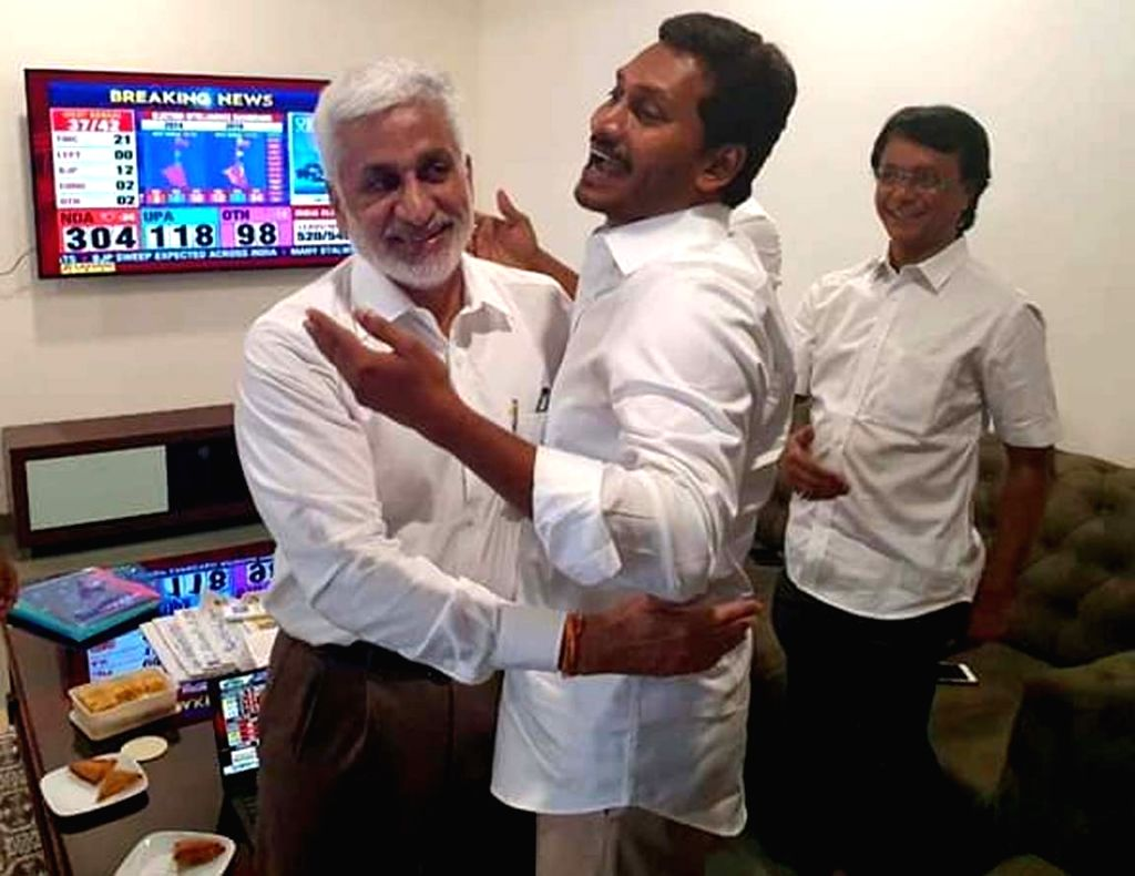 Amaravati: YSR Congress Party (YSRCP) chief Jagan Mohan Reddy celebrates after his party emerged victorious in the Andhra Pradesh Assembly elections in Amaravati, on May 23, 2019. He will take oath as the new Chief Minister of Andhra Pradesh on May 3 - Jagan Mohan Reddy