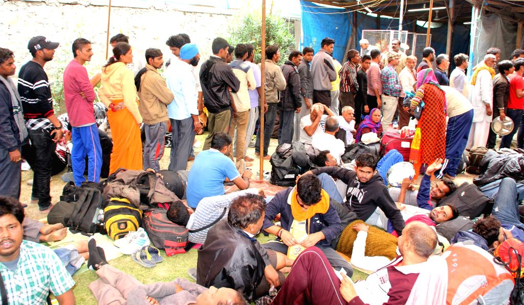 Amarnath Yatra pilgrims rest at a Srinagar temple  as curfew continued in parts of the Kashmir Valley amid fears of more violence where 21 people have been killed in clashes with police ...