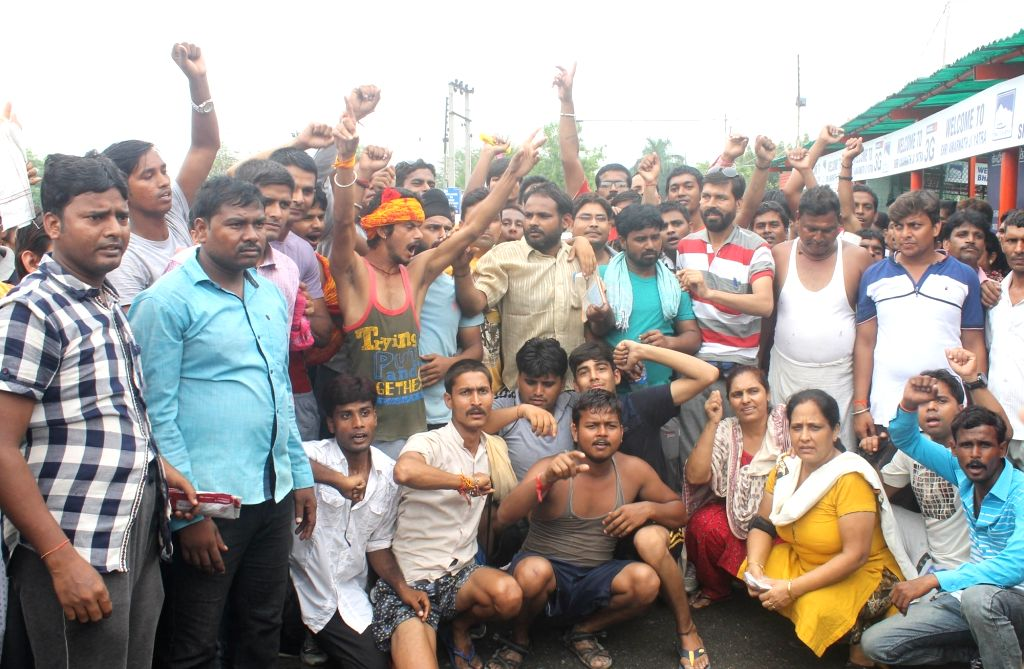 Amarnath Yatra pilgrims stage a demonstration at Bhagwati Nagar base camp in Jammu as the yatra remained suspended for the second day on July 15, 2016.