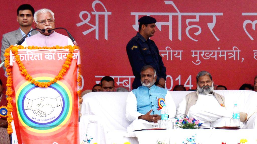 Haryana Chief Minister Manohar Lal Khattar addresses during a `State Level Sahkari Diwas Samaroh` at Ambala, Haryana on Nov. 20, 2014.