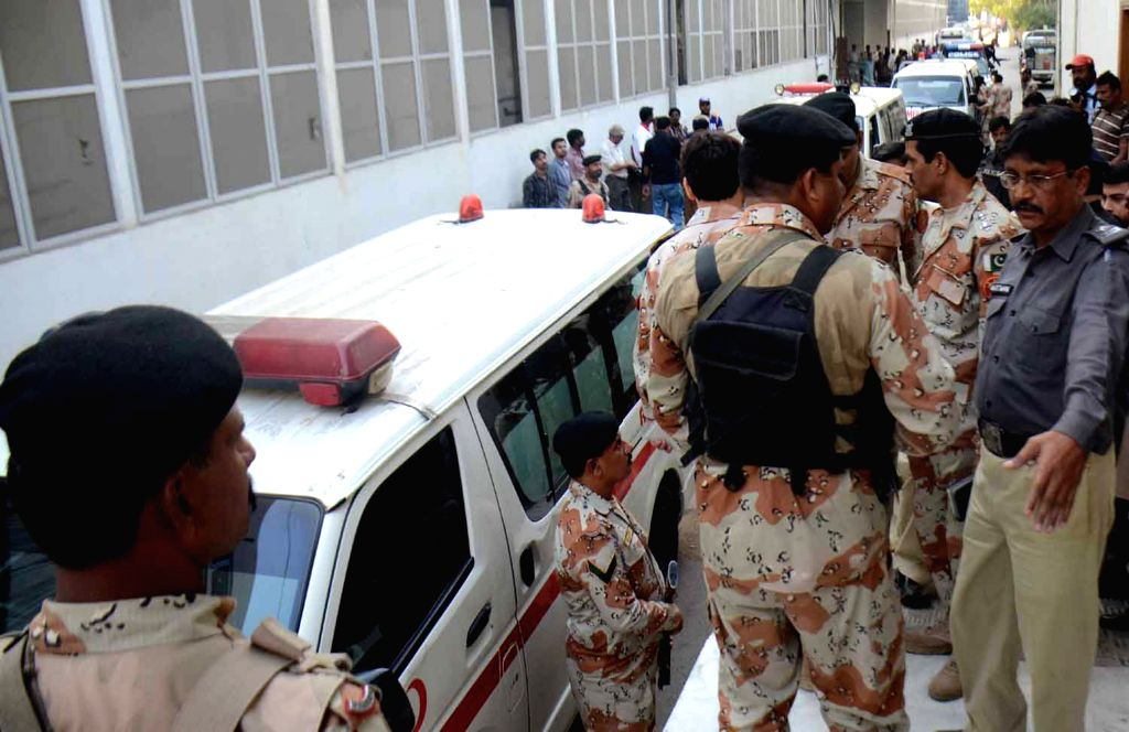 Ambulances carrying bodies of victims arrive at a hospital in Karachi, Pakistan, Nov. 20, 2015. At least three Paramilitary troops were killed while stopping ...
