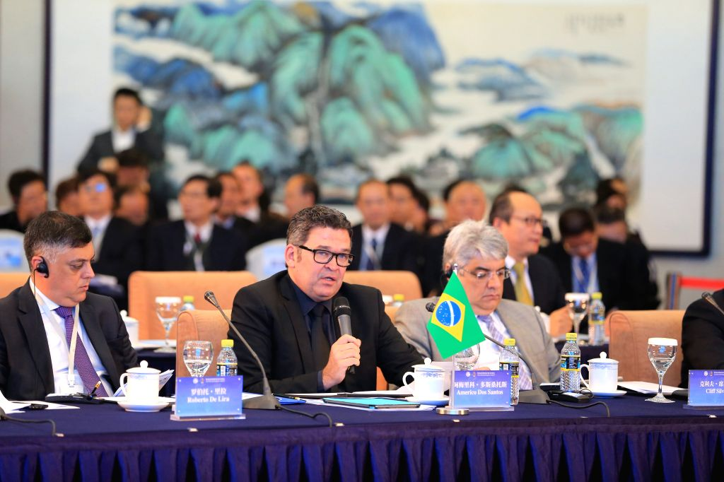 Americo Martins Dos Santos (C), president of the Brazil Communication Company, addresses the first BRICS Media Summit in Beijing, capital of China, Dec. 1, 2015. ...