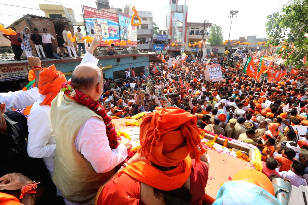 Amethi: BJP chief Amit Shah during a roadshow ahead of the 2019 Lok Sabha elections, in Uttar Pradesh's Amethi on May 4, 2019. (Photo: IANS) - Amit Shah