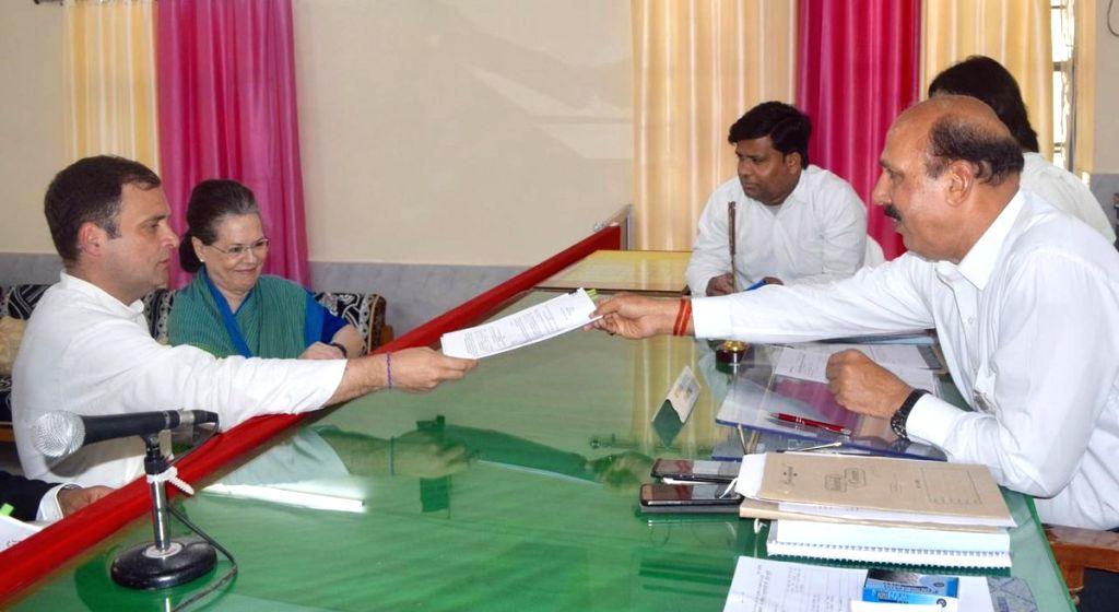 Amethi: Congress President Rahul Gandhi accompanied by UPA chairperson Sonia Gandhi, files his nomination from Uttar Pradesh's Amethi Lok Sabha constituency for the 2019 Lok Sabha polls, in Amethi, Uttar Pradesh, on April 10, 2019. (Photo: IANS) - Rahul Gandhi and Sonia Gandhi