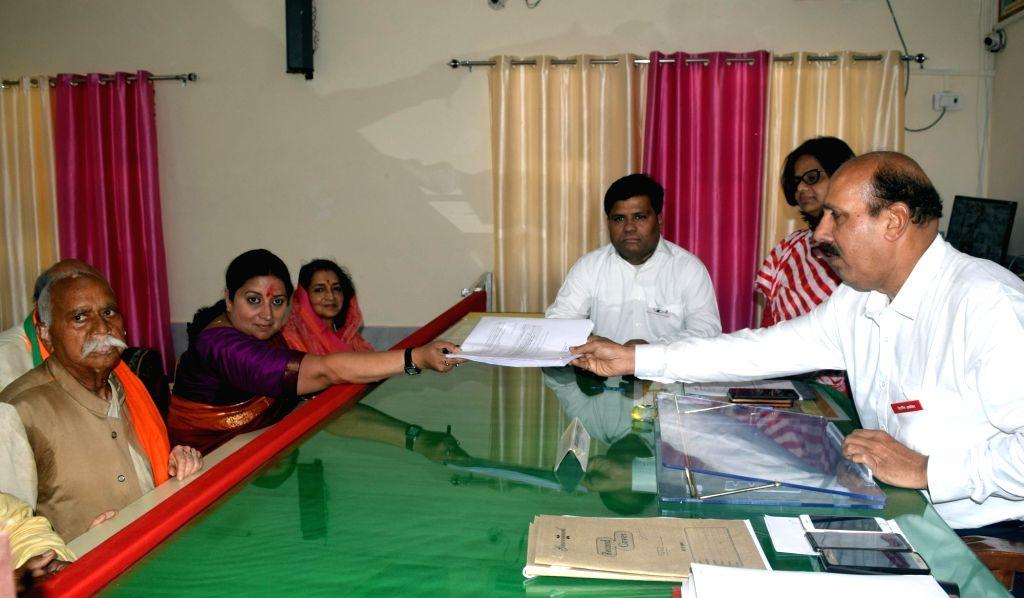 Amethi: Union Minister and BJP's Lok Sabha candidate from Amethi, Smriti Irani files her nomination for the 2019 Lok Sabha elections, in Uttar Pradesh's Amethi, on April 11, 2019. (Photo: IANS) - Smriti Irani
