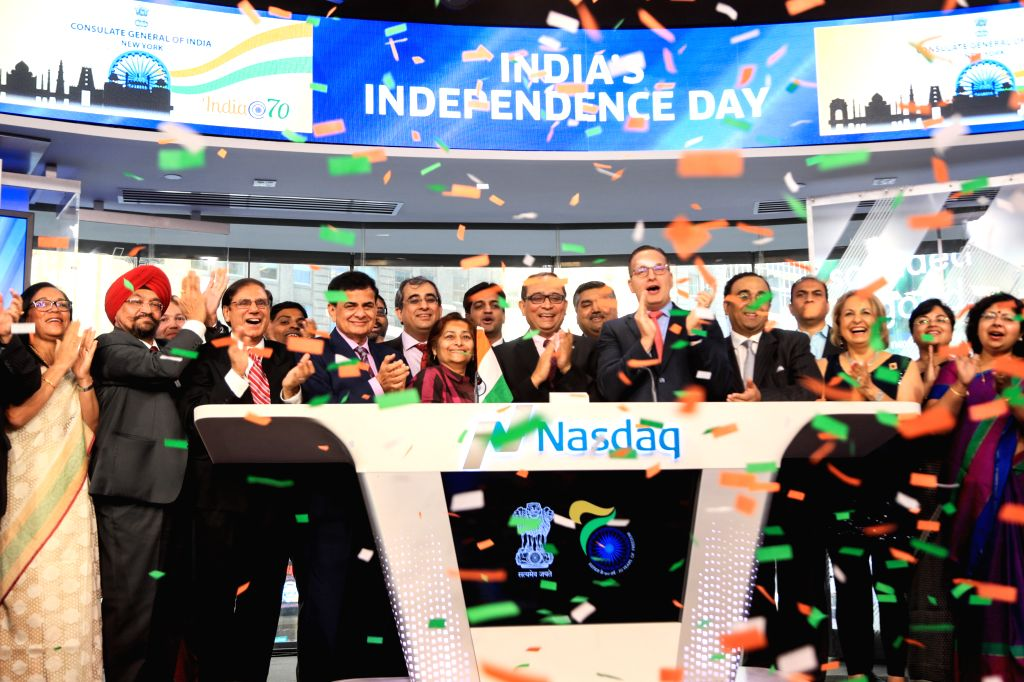 Amid a cascade of confetti, India's New York Consul-General Sandeep Chakravorty rings the opening bell at the NASDAQ stock market on Wednesday, Aug. 16, 2017, to celebrate India's Independence Day. ...
