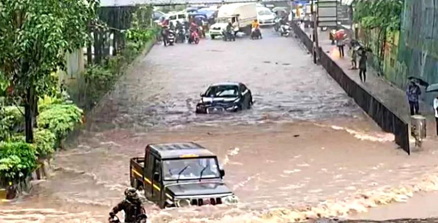 Amid heavy rain that has disrupted normal life here, with people posting pictures and videos on the citys flooded roads, a video has gone viral showing a Jaguar is stranded in a flooded underpass at ...