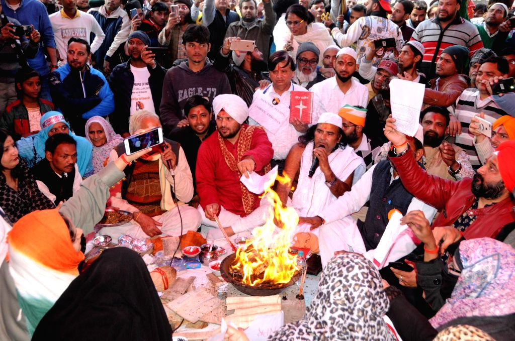Amid the ongoing protest at Shaheen Bagh against the Citizenship Amendment Act, people from all religions offering prayers, burn the copies of the bill, in New Delhi on Feb 6, 2020. The ...