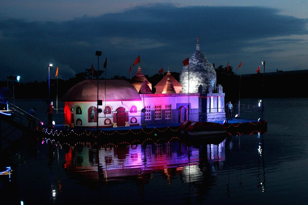 Amingaon: A floating replica of the Kamakhya Temple seen in the Brahmaputra River during the annual four day Ambubachi Mela, in Amingaon, Assam, on June 22, 2019. (Photo: IANS)