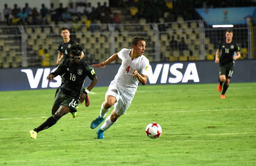 Amir Esmaeil Zadeh (White Jersey - No.4 ) of Iran and John Yeboah (Green Jersey - No.18) of Germany in action during a FIFA U-17 World Cup Group C match between Iran and Germany at ...