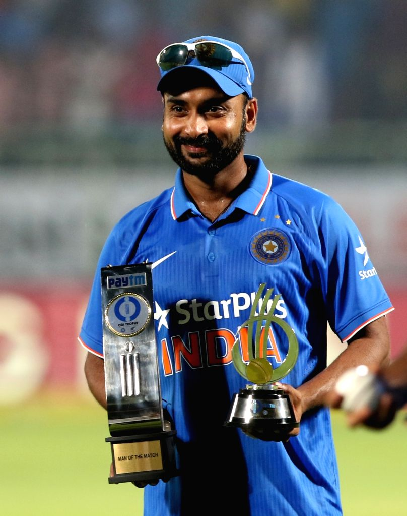 Amit Mishra of India with the player of the match and series trophy during the presentation ceremony at Dr. Y.S. Rajasekhara Reddy ACA-VDCA Cricket Stadium in Visakhapatnam on Oct 29, ... - Amit Mishra