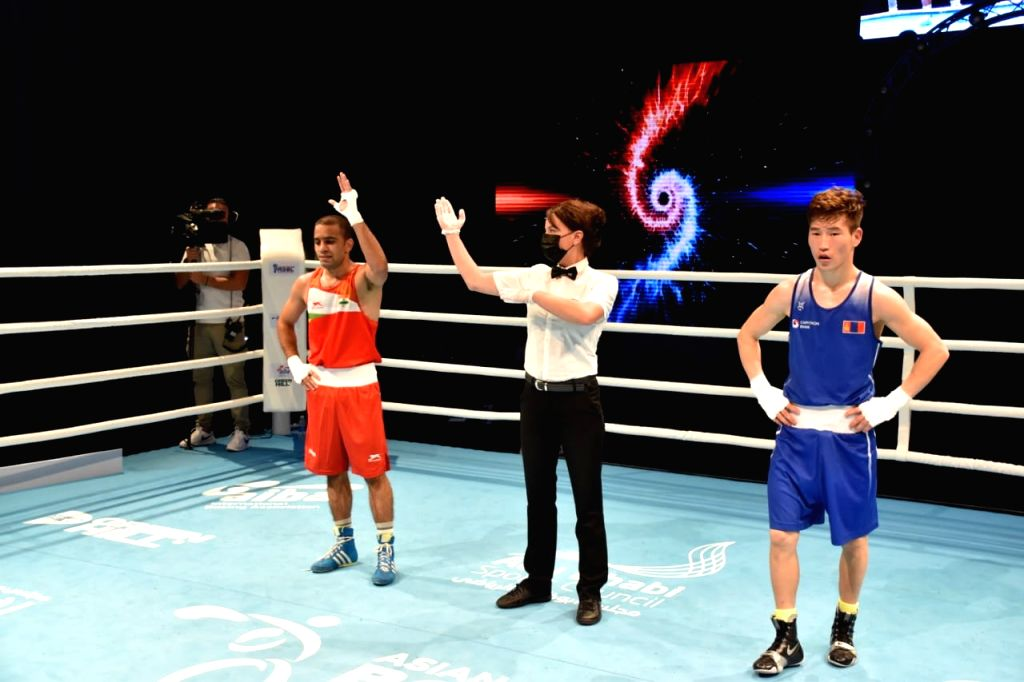 Amit Panghal (52kg) defeated Kharkhuu Enkhmandakh of Mongolia 3-2 in the quarter final  to secure another medal for India.