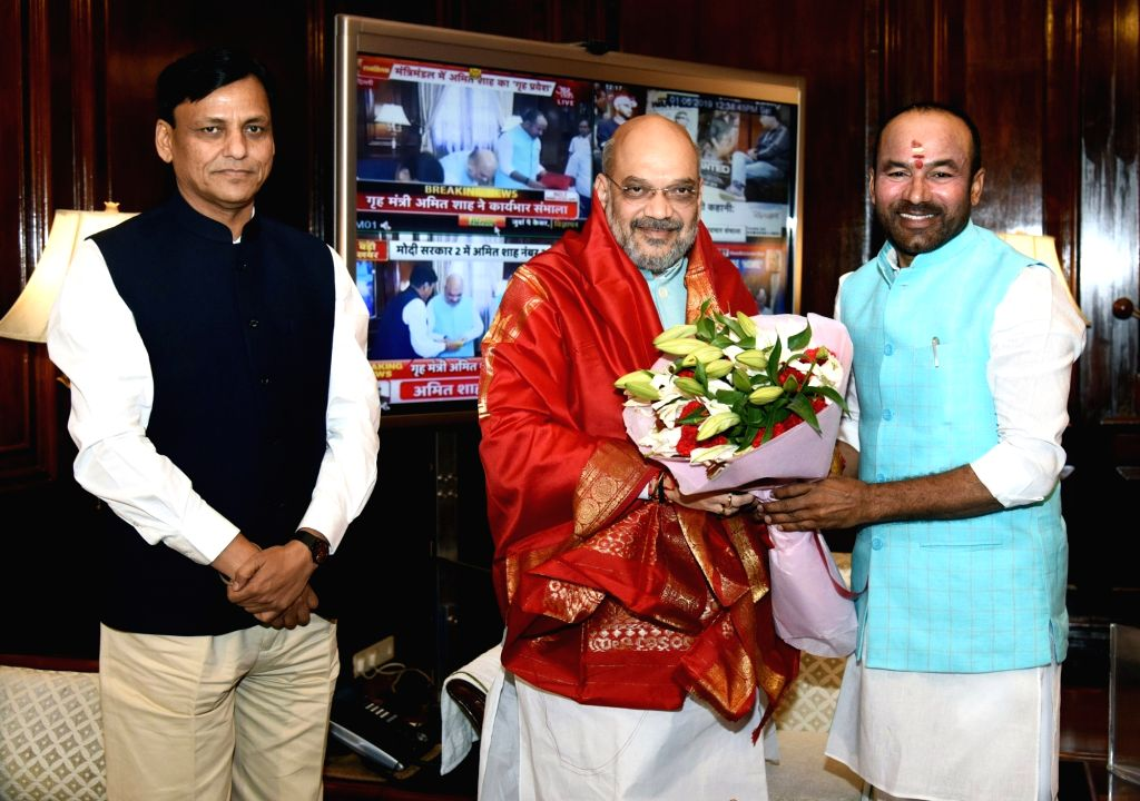 Amit Shah being greeted by Ministers of State for Home Affairs Nityanand Rai and G. Kishan Reddy, as he takes charge as the Union Minister for Home Affairs, in New Delhi on June 1, 2019. - Amit Shah, Affairs Nityanand Rai and G. Kishan Reddy