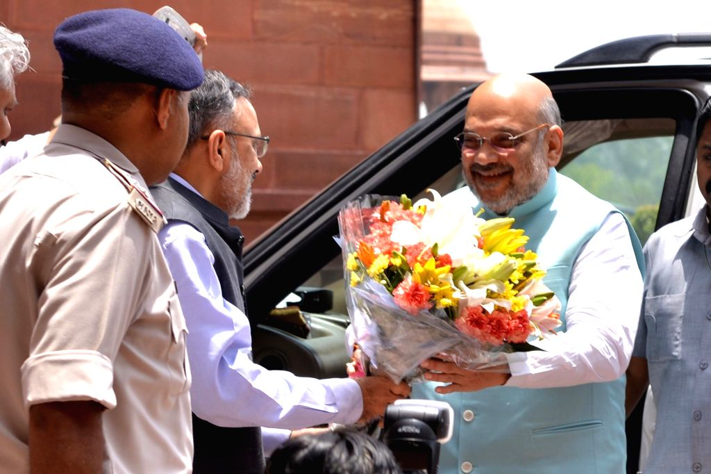 Amit Shah being greeted on his arrival to take charge as the Union Minister for Home Affairs, in New Delhi on June 1, 2019. - Amit Shah