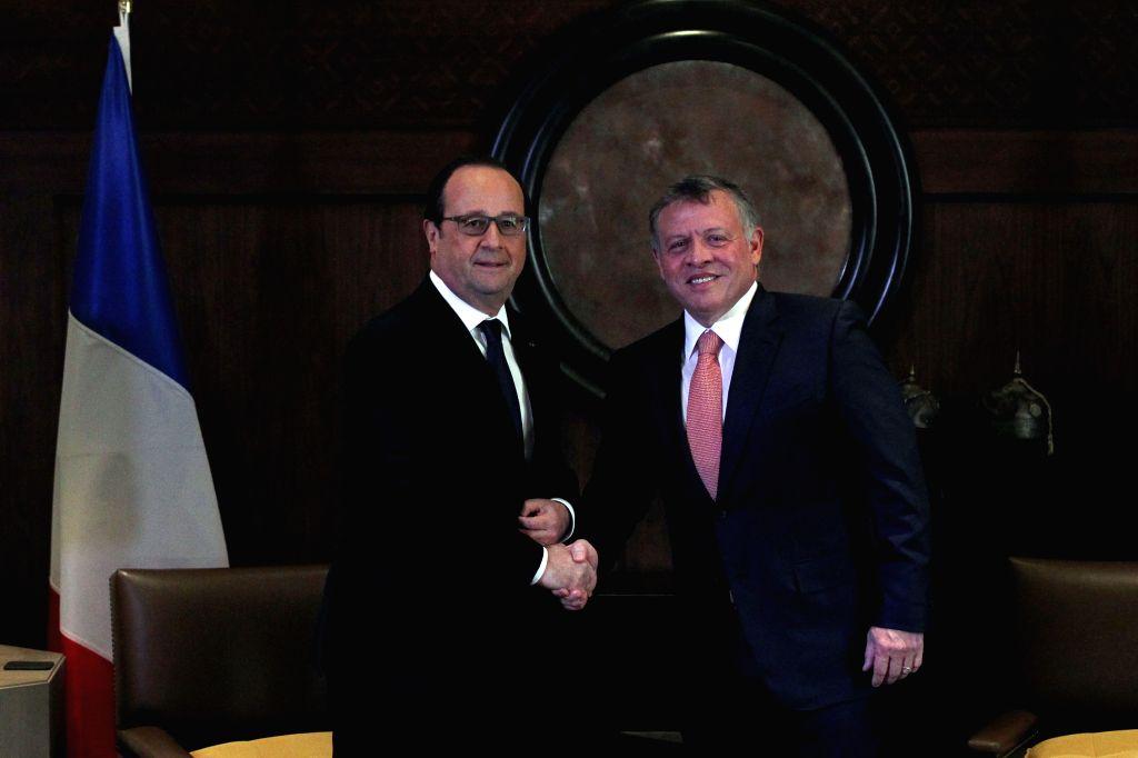 AMMAN, April 19, 2016 - Jordanian King Abdullah II (R) shakes hands with French President Francois Hollande at the Royal Palace in Amman, Jordan, on April 19, 2016.