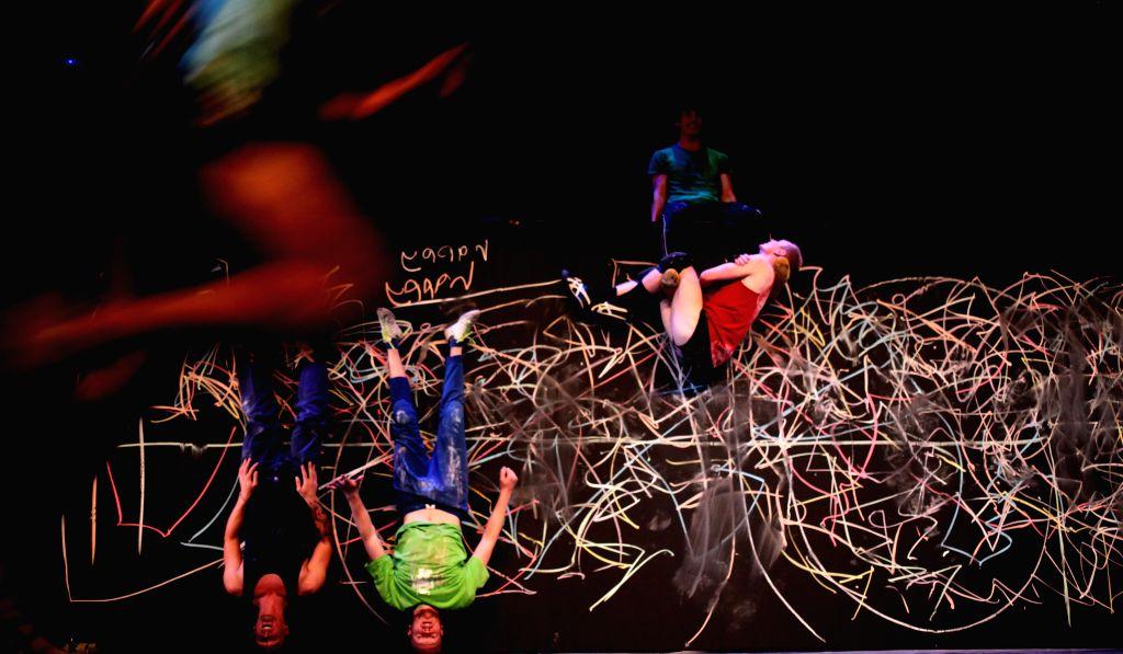 "Members of Australian dance company Shaun Parker perform ""Happy as Larry"" during the Amman Contemporary Dance Festival (ACDF) in Amman, Jordan, April 19, .."