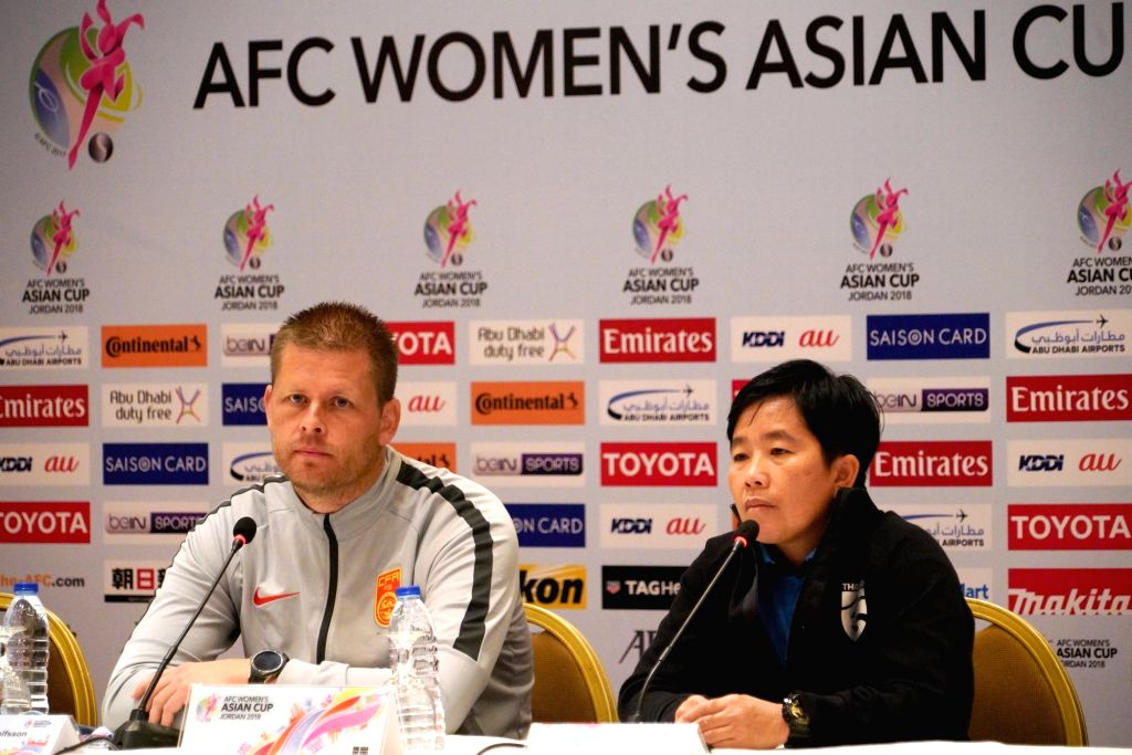 AMMAN, April 5, 2018 - China's head coach Sigurdur Eyjolfsson (L) and Thailand's head coach Nuengrutai Srathongvian attend the press conference ahead of the opening game between China and Thailand at ...