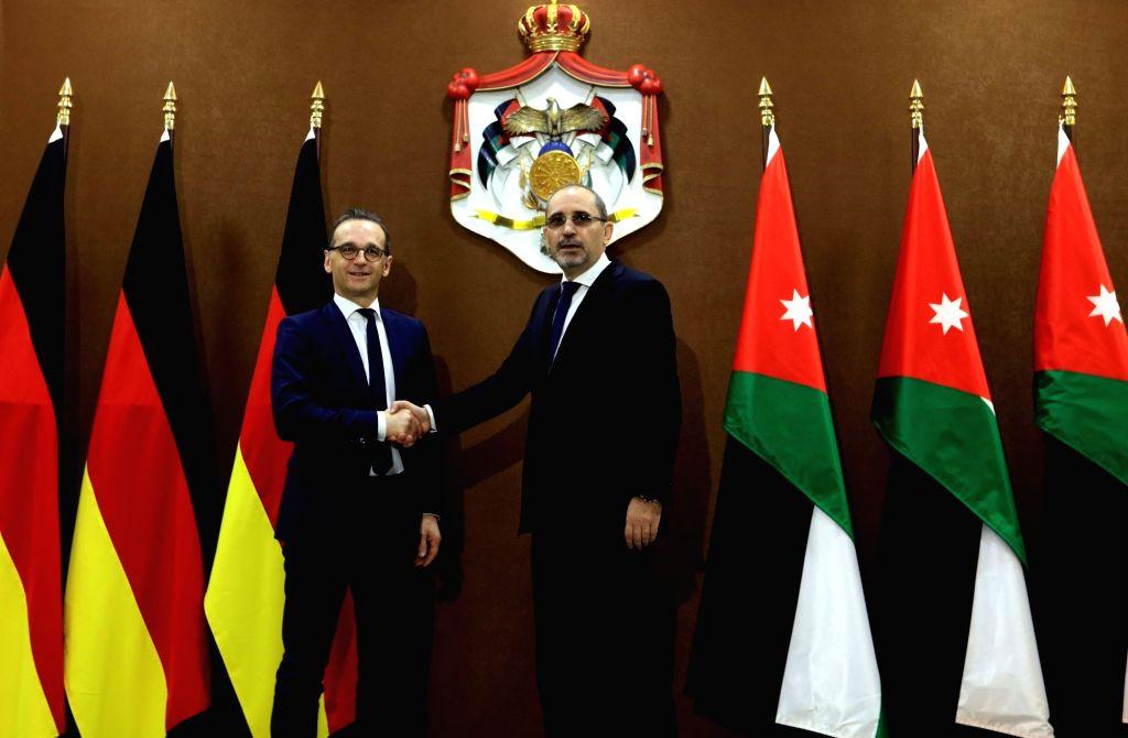 AMMAN, April 5, 2018 - Jordanian Minister of Foreign Affairs Ayman Safadi (R) shakes hands with German Foreign Minister Heiko Maas in Amman, Jordan, April 5, 2018. - Heiko Maas