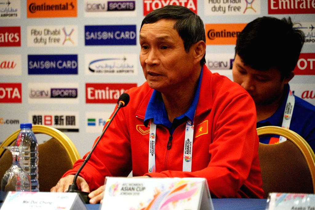 AMMAN, April 6, 2018 - Mai Duc Chung (front), head coach of Vietnamese women football team, attends a press conference prior to the match between Japan and Vietnam at 2018 AFC Women's Asian Cup in ...